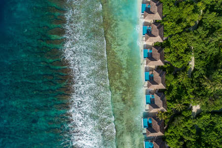 Aerial view of beautiful island at Maldives in the Indian Ocean. Top view from drone. Stockfoto - 127762555