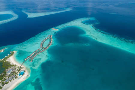 Aerial view of beautiful island at Maldives in the Indian Ocean. Top view from drone. Stockfoto - 127762557