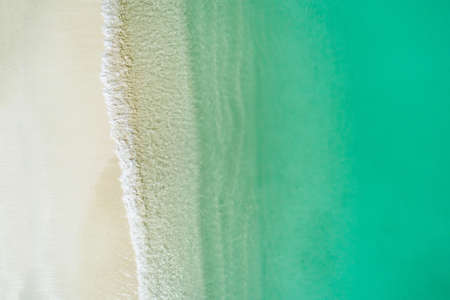 Beautiful tropical white empty beach and sea waves seen from above. Maldives beach aerial view. Top view from drone Stockfoto