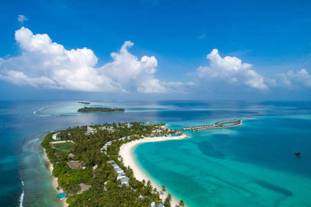 Aerial view of beautiful island at Maldives in the Indian Ocean. Top view from drone.
