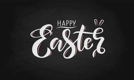 Hand drawn white lettering happy Easter on a chalkboard background