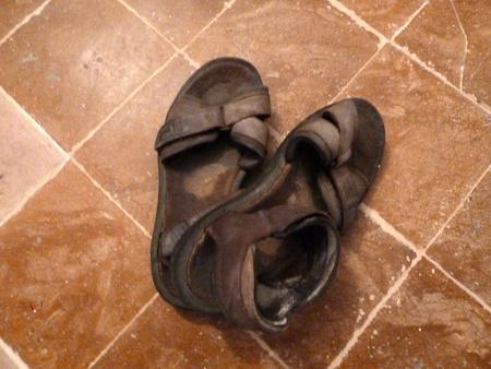 tatty: old tatty sandals on a terracotta floor