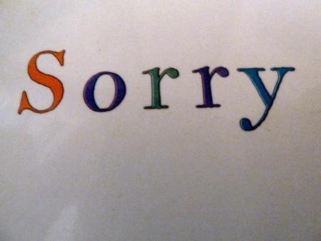apologetic: concept of being sorry on white