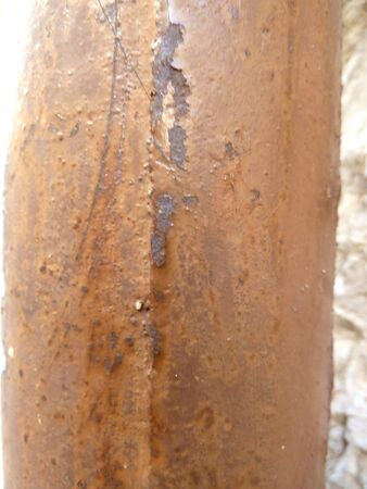 old rusty pipe in sunlight as a background photo