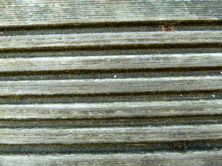grooves: Wooden deck board with deep routed grooves
