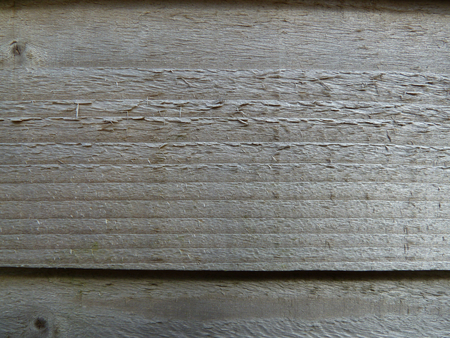 fence panel: Horizontal lines of a section of a wooden fence panel