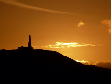 stock photos: Old decaying hilltop monument in bright sunset
