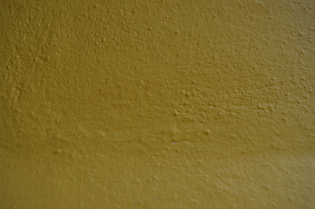 Unusual textured yellow surface as a background Stock Photo
