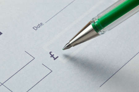 business transaction: Writing a cheque in green ink