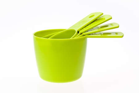 measuring: Four greem measuring cups Stock Photo