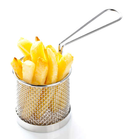 french fried potato: french fries in a restaurant presentaion basket