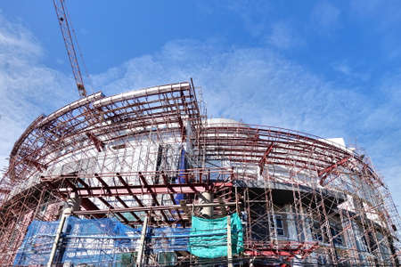 concrete commercial block: Construction site with crane and building