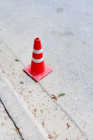 bitumen: traffic cone on bitumen pavement