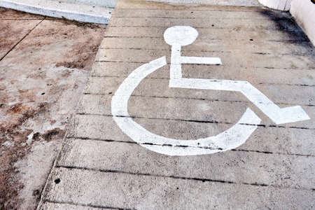 handicap sign: Ramped access with handicap sign