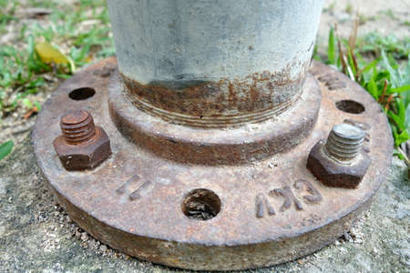 metal base: Close up of some larger screws into the base of a metal pillar