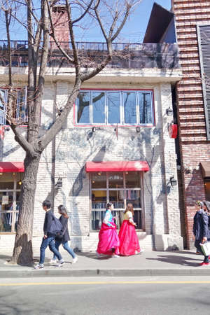 local festivals: A group of young girls in Korean traditional dress Hanbok are walking along the street of Seoul