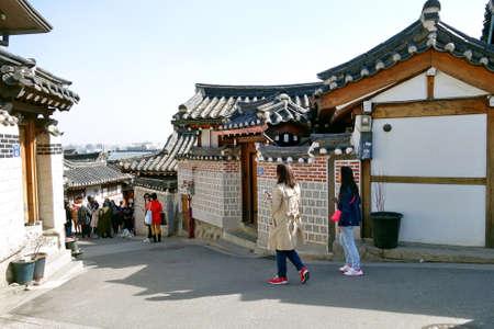 korean style house: Tourists walk in the beautiful scenery around Bukchon Hanok Village,Traditional Korean style architecture in Seoul, South Korea. Editorial