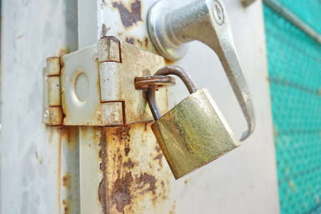 keep gate closed: old and rusty padlock
