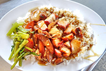 chinese food: BBQ Pork and Crispy Pork with Rice Stock Photo