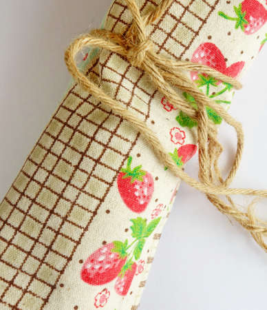 toweling: Cute table cloth tied with jute rope. Stock Photo