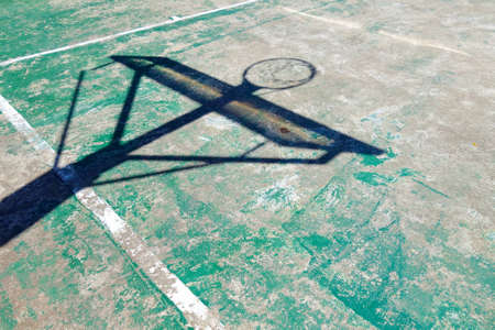 Concrete basketball court with shadow hoop Stock Photo