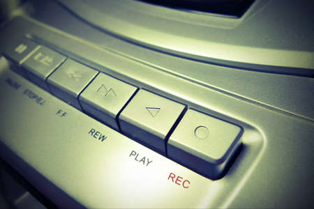 stereo cut: Play button on cassette player, vintage filter