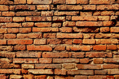 uneven: Old Uneven Crumbling Red Brick Wall Background