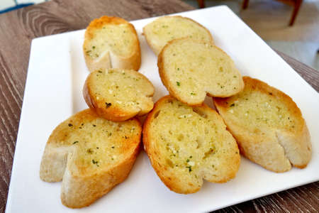 side order: Garlic Bread on plate Stock Photo