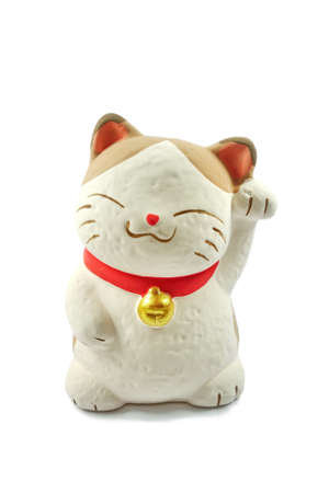 lucky charm: Maneki-neko, Japanese beckoning cat.A common Japanese figurine (lucky charm, talisman) which is often believed to bring good luck to the owner.