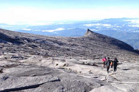 Hiker Walking at the Top of Mount Kinabalu in Sabah, Malaysia Stock Photo