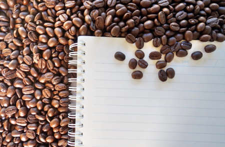 blank notebook with coffee beans background. Stock Photo