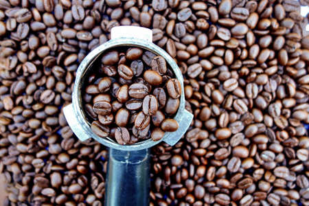tamper and coffee beans for background.
