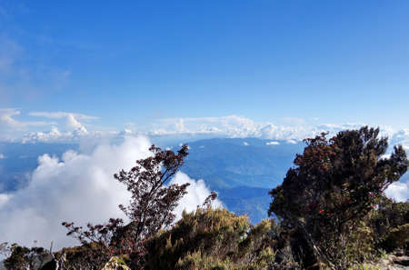 view point from top peak with cloudscape and blue sky. Stock Photo