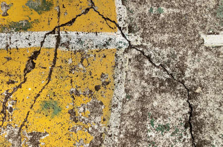 old yellow basketball court, grunge concrete background. Stock Photo