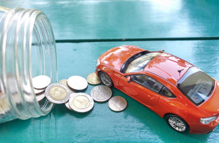 car and money coins. car Loan concept. Stok Fotoğraf