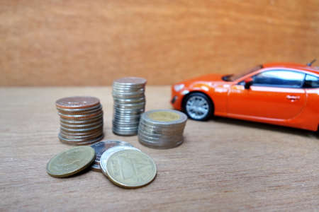 car and money coins. car Loan concept. Stock Photo