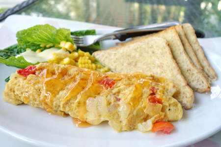 Veggie omelette, healthy breakfast with salad and bread.