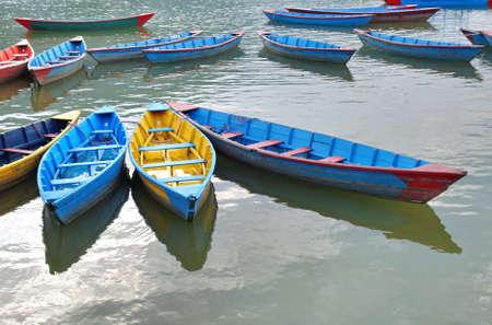 Colorful boats on Phewa Tal (Fewa Lake) in town of Pokhara , Nepal