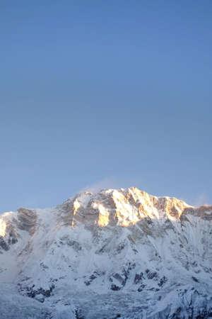 Annapurna peak with golden light of sunrise, Nepal.