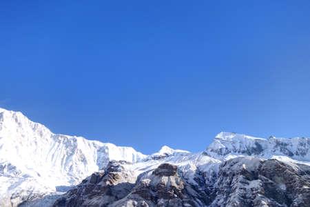 Hillary peak in Annapurana massif, snowed mountain with blue sky background. Stock Photo