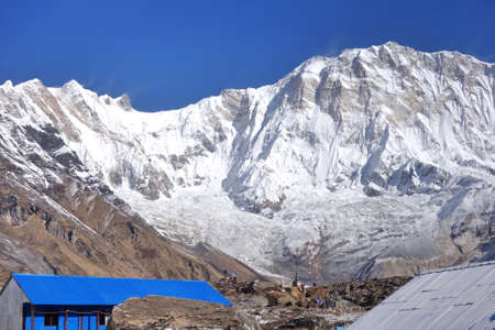 Small lodge at Annapurna base camp with snow mountain in backgroup.
