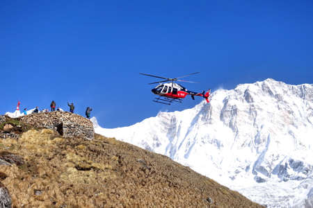 Nepal, 18 APRIL 2018 : Rescue helicopter in action, at Annapurna base camp.