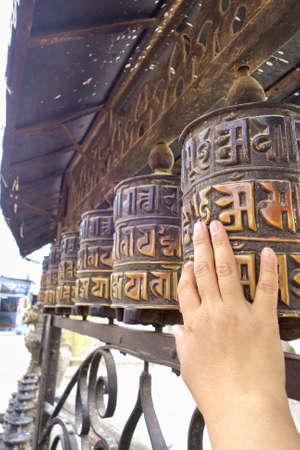 Prayer wheels at temple in Kathmandu, Nepal