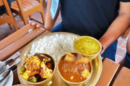Dal bhat, a traditional meal platter of Napal and India, consist of rice, dal,yogurt or curry made of chicken, goat meat or fish.