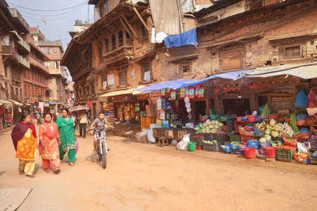 BHAKTAPUR, NEPAL - 27 APRIL, 2018: Street of local market in Bhaktapur, the ancient Newar city in the eastern of the Kathmandu Valley, Nepal