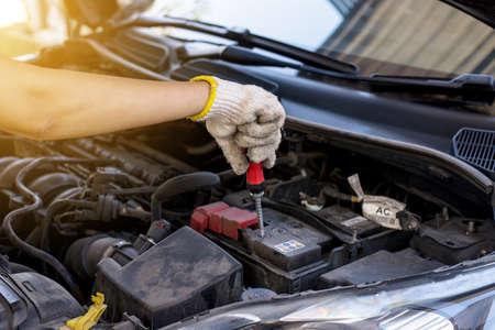 Closeup of hand mechanic engineer fixing car battery at garage,concept car maintenance