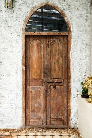 Old wooden brown door with old metal door handle