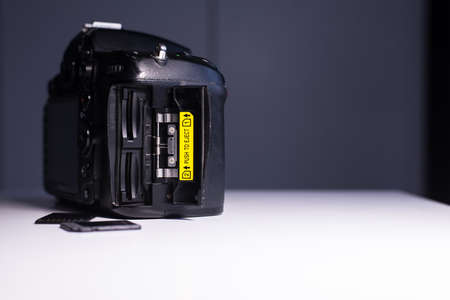 Digital DSLR camera with open memory card port,Concept of photographer work station,Close up photo