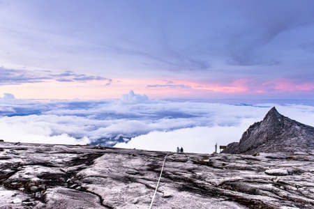 View of top with cloudy Kinabalu mountain in kinabalu national park,Kota kinabalu,Sabah Malaysia,South Peak and lows peak