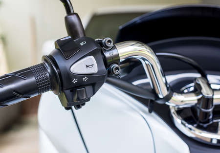 Motorcycle handlebar horns,turn signal,high-low front light button,Close up 版權商用圖片